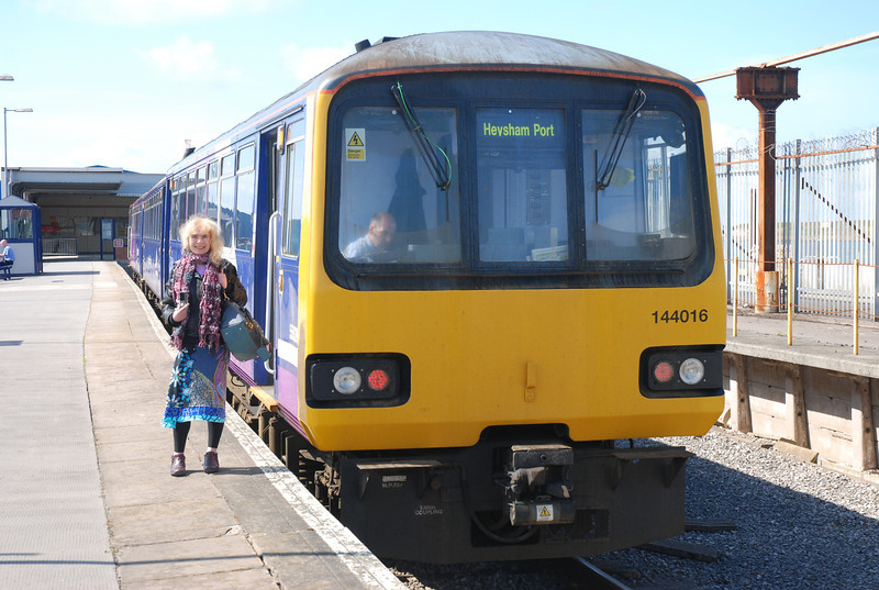Liz next to 144016 <br /> <br /> waiting to work the 13.15 Heysham Port - Leeds back out. You get <br /> <br /> roughly 20 mins to get all the pictures and back on the train which is <br /> <br /> adequate time to get some decent pictures