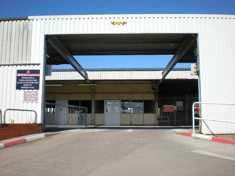 Picture by Liz: <br /> <br /> The road entrance into the station concourse the as it was deserted <br /> <br /> Car Park is behind and to the Left of Liz