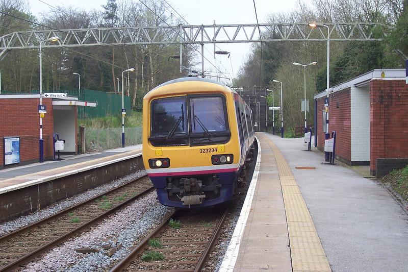323 234 <br /> <br /> Location <br /> <br /> Styal Manchester bound Platform <br /> <br /> Date<br /> <br />  12 April 2007 <br /> <br /> working<br /> <br />  17.33 Crewe - Man Picc service<br /> <br /> 323 234<br /> <br />  arrives soon after the Crewe bound service left