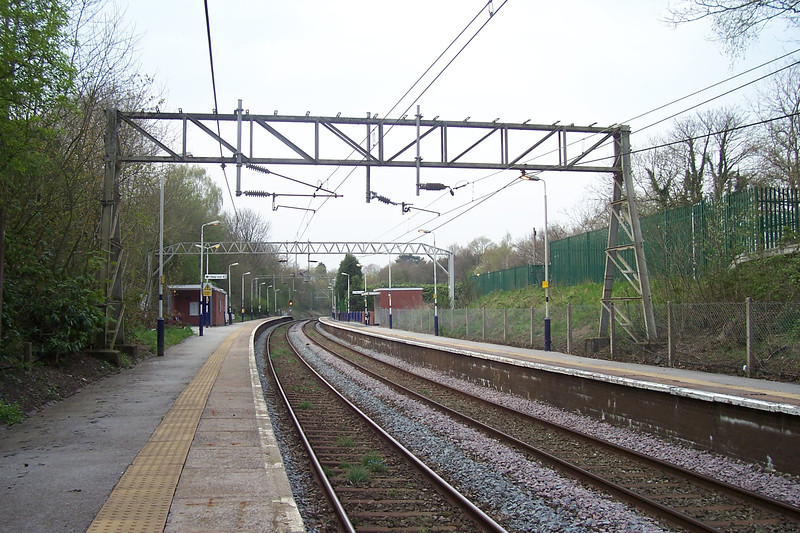 Styal Station platform looking towards Manchester & just round the <br /> <br /> bend in the distance is Heald Green South Jct that leads to <br /> <br /> Manchester Airport Branch