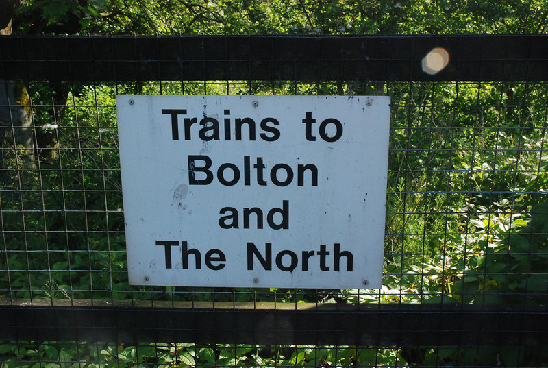 The sign that tells ya which way the trains are heading was still here