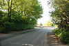 Shot taken from other side of road to previous shot looking back down Rake Lane this is the view you get as you approach the station