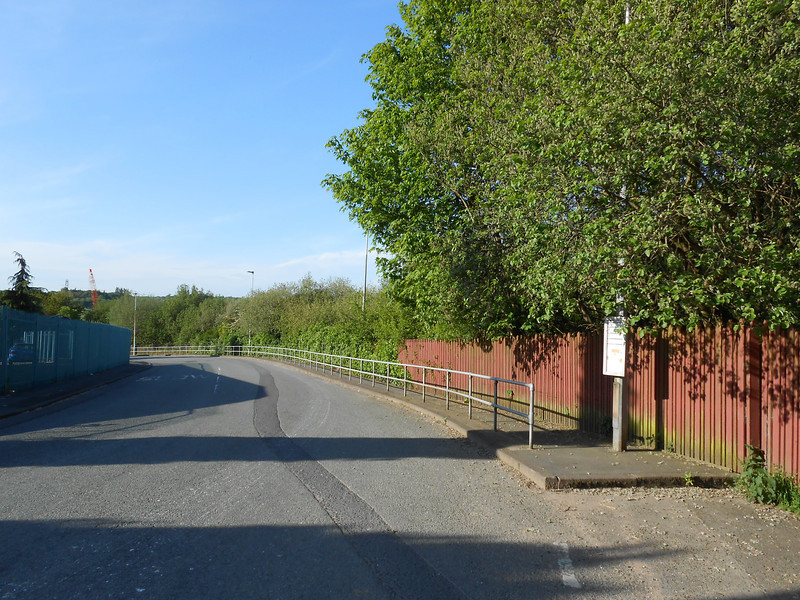 Pic by LIz <br /> <br /> This is the road the other side of the Bridge the bus stop back to <br /> <br /> Swinton is on the Right and the entrance road down to the <br /> <br /> Manchester bound plat is also on the right