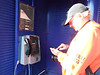 Pic by Liz <br /> <br /> The phone didn't seem to be working, <br /> <br /> Ghost Station Man dials the phone on his Mobile to double check that it would ring or not <br /> <br /> Answer <br /> <br /> Not