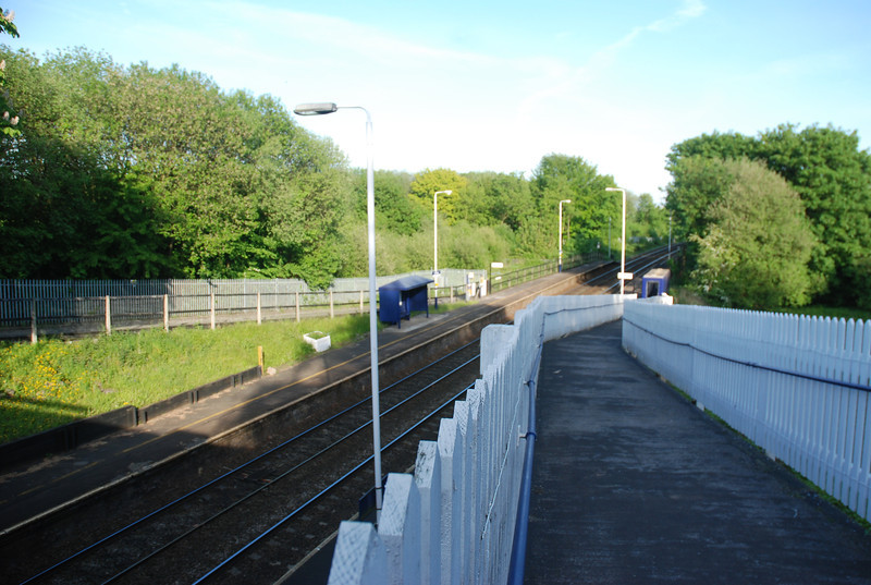 Shot of the station from over the top of the Exit ramp fence looking down on to the Manchester bound platform