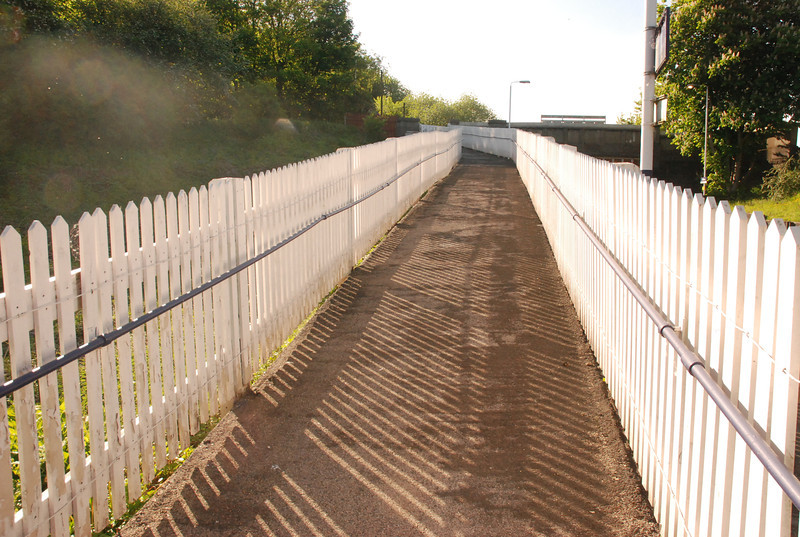 Shot taken from the bottom of the exit ramp looking up towards the exit and Rake Lane Road