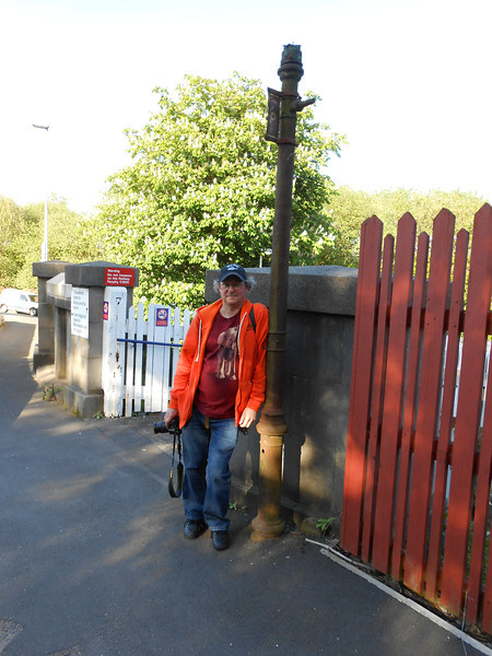 pic by Liz <br /> <br /> Ghost Station Man <br /> <br /> Stands next to the Bonus find of the trip so far the old bus stop sign