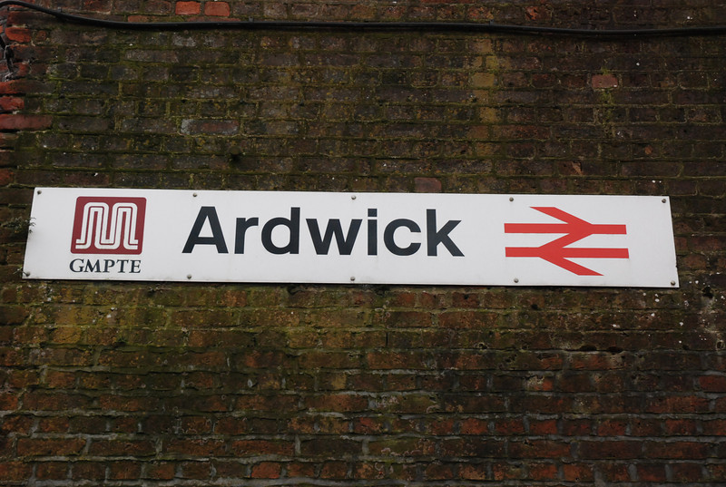 Close up of the Ardwick station sign on the wall
