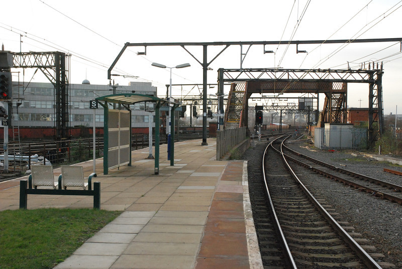 Looking towards Manchester with the line from Stockport coming in<br /> <br />  on the left of the picture the only way out is via the Footbridge and a <br /> <br /> winding walk along a path as you will see in a minute