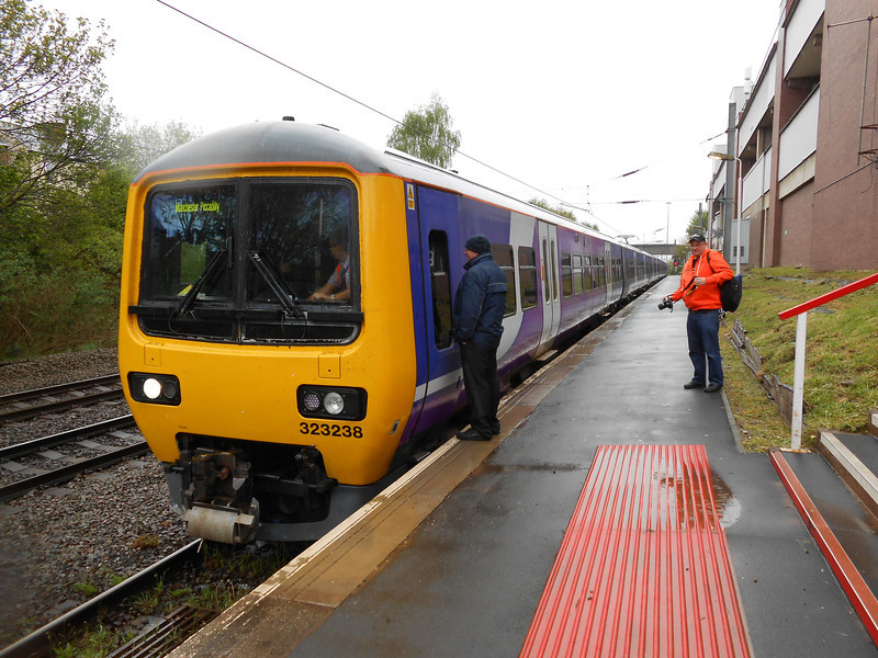 Pic by Liz <br /> <br /> Ghost Station Man <br /> <br /> Watches Liz as she gets a shot of the whole of the platform looking <br /> <br /> towards Trafford Park Now with 323 238 Leading and 323 223 on the <br /> <br /> rear waiting to work back to Manchester Piccadilly as <br /> <br /> 5T02 14.36 Manchester United Platform - Manchester Piccadilly <br /> <br /> Empty Stock Move (ECS)