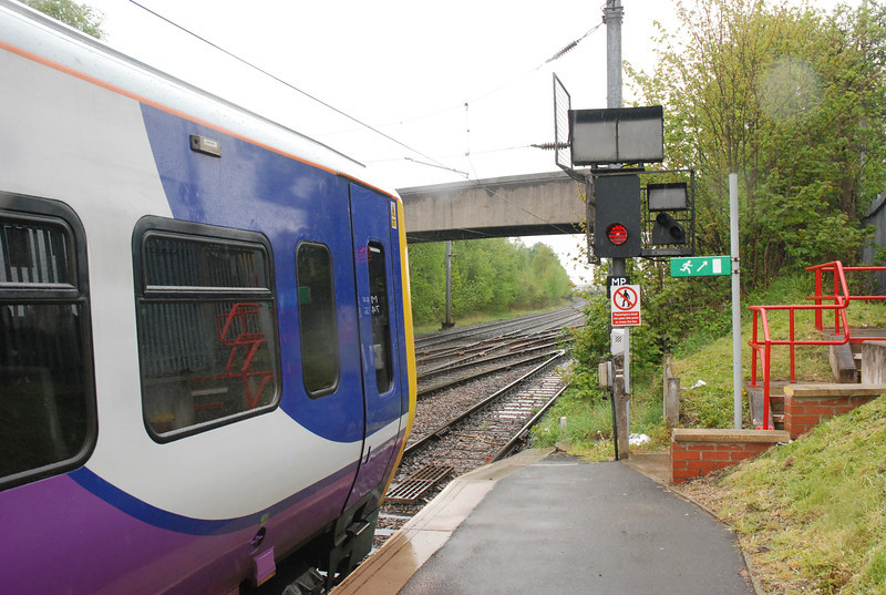 323 223 <br /> <br /> At Journeys end sits in front of Signal MP 743<br /> <br /> looking towards Trafford Park Station <br /> <br /> The Freightliner terminal is just out of sight other side of the concrete bridge to the right