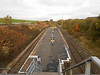 Pic by Liz <br /> <br /> Denton station looking towards Guide Bridge comapre this with the <br /> <br /> other pics from way back in 2006 when Denton didnt even have a <br /> <br /> sign on the platform now it's all been re tarmacked and new flower <br /> <br /> beds etc as you will see