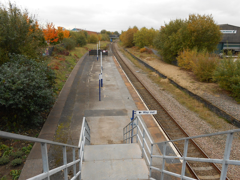 pic by Liz <br /> <br /> Date of visit 23rd Oct 2012 <br /> <br /> Shot taken by Liz from the top of the stairs looking down the <br /> <br /> platform at Reddish South looking towards Denton <br /> <br /> This was Liz's first visit here and she was like 'whoo you werent <br /> <br /> joking when you said that Reddish South the total opposite to <br /> <br /> Reddish North'