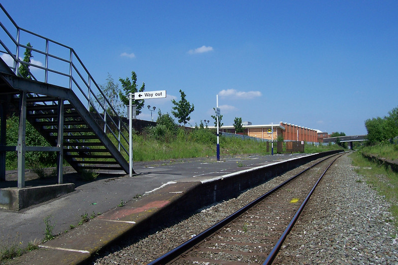 Side on profile shot of Reddish South looking towards Guide Bridge, <br /> <br /> you dont even get the luxury of a bench to sit on @ Reddish South. <br /> <br /> This station is very easy to get to you just do the train to<br /> <br /> Reddish North Get off turn left when u reach the main road and just <br /> <br /> keep walking or do the Bus and the Bus drops you off right outside if <br /> <br /> you go past the Morrissons you've missed it the entrance is a metal <br /> <br /> gate on the railway bridge<br /> <br /> Date of visit 2006