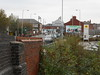 pic by Liz <br /> <br /> shot taken from the top of the entrance steps looking down Gorton <br /> <br /> Road towards Reddish North the Morrison Supermarket right next to <br /> <br /> the station on the right