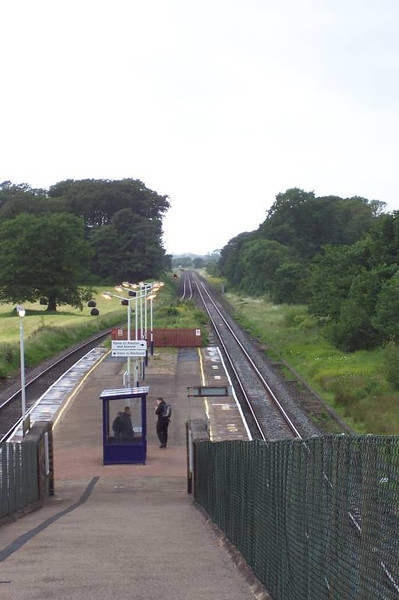Salwick station <br /> <br /> Taken from half way up the exit ramp looking towards <br /> <br /> Blackpool <br /> <br /> 22nd June 2006<br /> <br /> This trip was just to get the station in the book and it was all very <br /> <br /> rushed because It was literally get off and I had about 6 mins before <br /> <br /> the train headed back to Preston hence why me and Liz did a return <br /> <br /> visit in May 2013