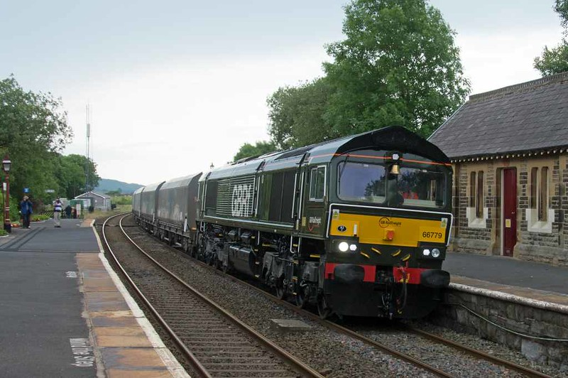 66779 Evening Star, 6M33, Horton-in-Ribblesdale, Wed 20 July 2016 - 1309 1. The last member of the enormously successful class 66 has a number of embellishments copied from 92220 including the latter's name, BR green livery and 82F (Bath Green Park) shed code.