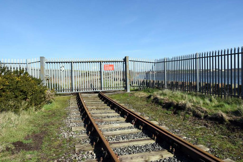 Ramsden dock branch, Barrow-in-Furness, 14 March 2017 2.  Looking north east.  The gate marks the boundary between Network Rail and Associated British Ports (ABP) trackage.  Just visible on the sleeper below the gate is the DRS limit of maintenance sign seen in the next photo.