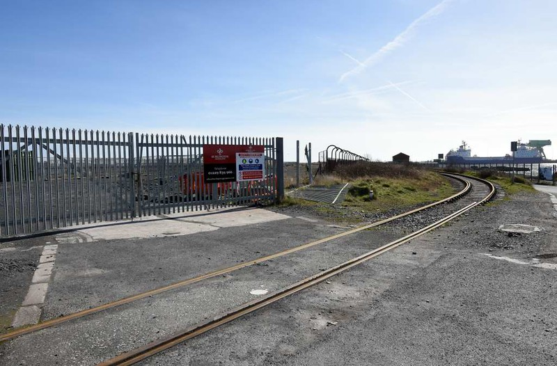 Ramsden dock branch, Barrow-in-Furness, 14 March 2017 4.  Looking south west towards the maritime terminal from near the NR / ABP boundary. Nice gates, shame about the fence!