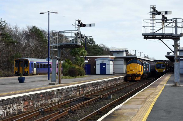 Full house at Barrow-in-Furness, 14 March 2017 - 1437.  153363 arrives with the 2C46 1208 from Carlisle; it subsequently went to the carriage sidings.  37402 Stephen Middlemore is about to depart with the 2C41 1437 to Carlisle; its consist was 6122, 6008, 6173 & DBSO 9709.  The set subsequently worked 2C42 1737 Carlisle - Barrow.  It  had previously worked 2C32 0515 Carlisle - Preston and 2C47 1004 Preston - Barrow.  185143 is about to depart with the 1N33 1441 to Manchester Airport; it had arrived with the 1C53 1320 from Lancaster.  These were all Northern services.