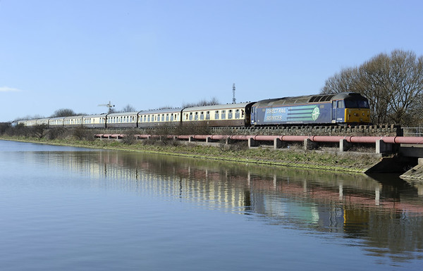 57008, 1Z22, Salthouse Junction, Barrow-in-Furness, 21 March 2015 1 - 1258.  The Cumbrian Docker skirts Cavendish dock as it returns to the junction where it will reverse and continue through Barrow to Workington.  57004 was on the rear.