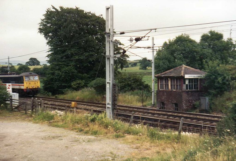 Lambrigg Crossing, 7 July 1992,  Looking south east at milepost 24 1/4.  The rear of the derailed Pendolino came to rest here; it had been travelling from right to left.  The eastern end of the Lambrigg crossovers is at right.  The signal box was an early LNWR / Saxby & Farmer A Type.  It closed as a block post on 30 April 1973 when Carlisle power box was commissioned, but was retained to control the level crossing until that closed on 18 April 1977, and then to control the crossovers.  The box was demolished in 1993 and replaced by an emergency ground frame. Photo by Colin Woof.