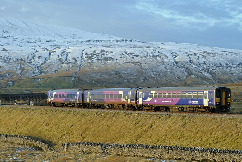 158843 & 153328, Ribblehead, Sat 28 January 2012 - 1602.  Northern's 1449 Leeds - Carlisle.
