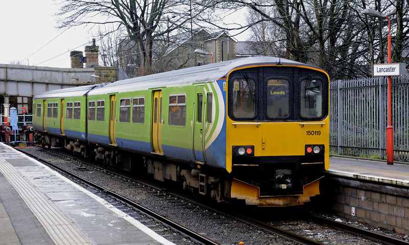 150119, Lancaster, Fri 20 January 2012 - 1345.  The former London Midland DMU stands with Northern's 1315 Heysham - Leeds.  NB the lack of Northern branding.