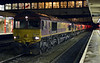 66148 (66094, 66063, 66087, 66008, 66003, 66017 & 60019 Port of Grimsby & Immingham DIT), 0X91, Lancaster, Sun 5 January 2014 - 1726.  A Carlisle - Warrington Arpley convoy with eight locos returning from engineering duties.