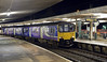 150137, 2H05, Carnforth, Wed 8 January 2014 - 1826.  Northern's 1639 Leeds - Morecambe sets down passengers.
