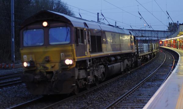 66102, 4C03, Lancaster,  Thurs 3 January 2012 - 1554.  DB Schenker's Washwood Heath - Carlisle Yard departmental, comprising Network Rail IFA sleeper carriers 7046290340, 7046290472, 7046290068, 7046290498, 7046290035, 7046290134, 7046290324, 7046290241, 7046290399, 7046290506, 7046290290, 7046290050, 7046290118, 7046290225, 7046290423, 7046290159, 7046290282 & 7046290126.