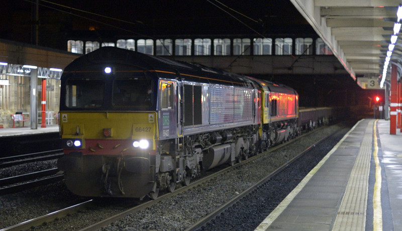 66427 & 66560, 6C02, Lancaster, Fri 9 January 2015 - 0616.  DRS's 0422 Crewe Basford Hall - Carlisle yard departmental.  This was a positioning move for 66560, which subsequently worked Freightliner's 6K13 1805 Carlisle - Irvine PW train.