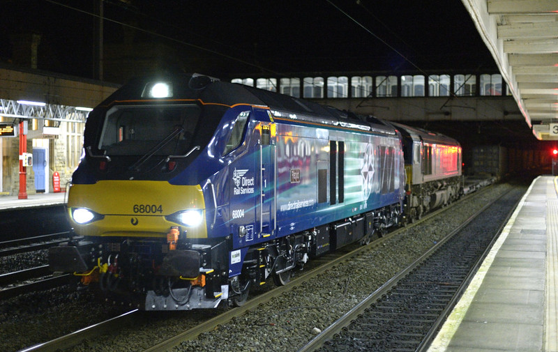 68004 Rapid & 66424 (DIT), 4S44, Lancaster, Tues 6 January 2015 - 1858.  DRS's 1213 Daventry - Coatbridge, 210 minutes late after the 66 failed near Nuneaton.  57302 took the train to Crewe, where the 68 took over.  66305 replaced both locos at Kingmoor.