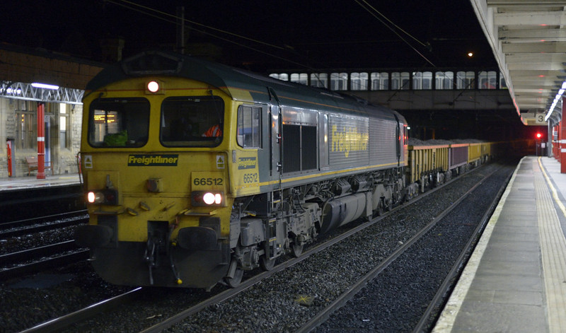 66512, 6Y16, Lancaster, Sat 10 January 2015 - 2031.  Freightliner's 1738 Basford Hall - Oxenholme PW.  The train weighed 757 tonnes, and the consist was reported as 29375, 503513, 7058920081, 29435, 503509, 503541, 29376, 29384, 503538, 29091, 29479, 7058920032, 29054, 29249, 29247, 29222, 29236 & 29188.  It ran through to Carlisle yard on the 11th.