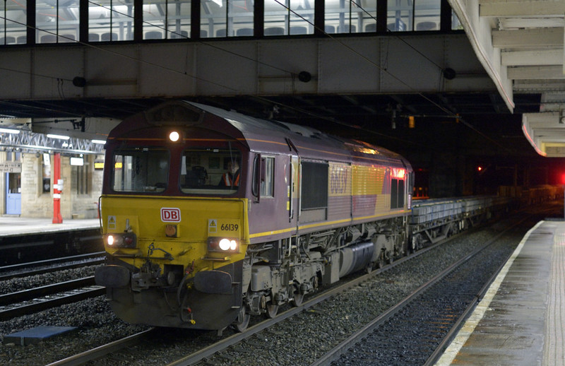 66139, 6L43, Lancaster, Sat 10 January 2015 - 2051.  DB Schenker's 1910 Basford Hall - Shap summit PW comes to a stand on the down fast, where it was overtaken by 390127 Virgin Buccaneer working Virgin's 1S95 1830 Euston - Glasgow.  The train weighed 994 tonnes, and the consist was reported as 996655, 996325, 996332, 996349, 110004, 29159, 29097, 29163, 29394, 29104, 29088, 29496, 29268 & 29270.  It ran through to Carlisle yard on the 11th, and 66193 ran light to Arpley with 66090 & 60063 (0L43).