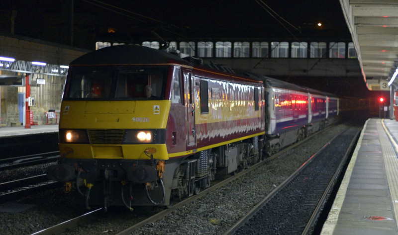 90020, 1S26, Lancaster, Fri 9 January 2015 - 0607.   ScotRail's 2350 Euston - Glasgow / Edinburgh Caledonian sleeper heads north 117 minutes late.  It had arrived early at Preston, but then had to wait for its (booked) relief crew off 1M11 (90024)  which reached Preston 129 late after storms in Scotland.  Also, a 50 mph speed limit was in force overnight between Preston and Gretna Junction because of high winds.  1S26 was held on the down slow line at Penrith while the DB Schenker 66 (0M75) off the Margam - Hardendale lime (6M75) ran ahead to prove the line.  (There had been debris on the track between Carlisle and Penrith.)  The train eventually reached Glasgow at 0903 105 late, having detached the Edinburgh portion at Carstairs.  The 16 coaches were reported as 10617, 10561, 10553, 10690, 10523, 10714, 6704, 9801, 10598, 10504, 10600, 10597, 10531, 10648, 1210 & 9810.  1S25 reached Edinburgh at 0449, 51 late.  It was cancelled between Edinburgh and Fort William and between Perth and Inverness.  The Aberdeen portion arrived at 1031, 177 late.  67004 had hit a tree near Cupar but worked through to Aberdeen. 1M11 reached Euston at 0747, only 45 late.  1M16 (90019) arrived at 0859, 72 late, having run with its Fort William, Inverness and Aberdeen portions.