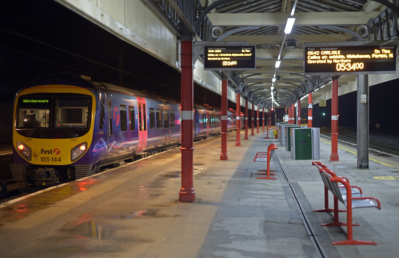 185144, 2C00, Lancaster, Fri 9 January 2015 - 0534.  First TransPennine Express's 0546 to Windermere awaits departure.  However, the indicator for platform 2 is showing the train as Northern's 1049 to Leeds!  The public address was doing the same!  The indicator at right for platform 3 is correct.