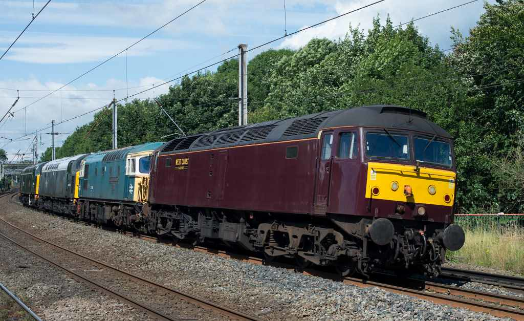 47237, 33109 Captain Bill Smith RNR, 40135 & 40106 Atlantic Conveyor, 0Z40, Lancaster, Fri 29 July 2016 - 1455 1.  The 0813 Bo'ness - East Lancashire Railway convoy runs slowly into Lancaster where it was about to be held on the up fast to allow Virgin's 9M56 1251 Edinburgh - Birmingham - Euston (390104) to pass.