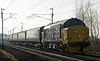 37403 Isle of Mull, 5C47, Carnforth, Fri 20 January 2017 - 1402.  DRS's 1310 Preston - Barrow with the stock off 2C47.  It had been cancelled after 37401 failed at Preston.  The consist was 6117, 6001, 6173 & DBSO 9707.  Unfortunately there were problems with coach 6001, and it had to be detached at Barrow.  37401 was left at Preston and was later taken to Kingmoor by 57304.  Coach 6001 was removed from Barrow by road on 31 January.