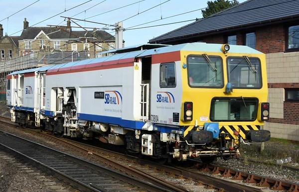 DR 73804 James Watt, Carnforth, Wed 15 March 2017 - 1605.  SB Rail's Plasser & Theurer 08-32U-RT tamper heads south on an 0912 Rutherglen - Crewe move.