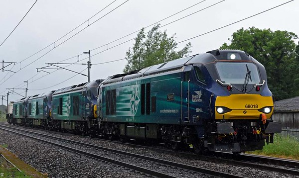 68018 Vigilant, 68016 Fearless, 68023 Achilles & 68001 Evolution, 6C53, Carnforth, Thurs 8 June 2013 - 0754.  Super power in the rain for DRS's 0630 Crewe - Sellafield flasks.  68018 & 68016 subsequently worked the 6C51 Sellafield - Heysham flasks, while 68001 & 68023 ran light 0K73 1723 Sellafield - Crewe.