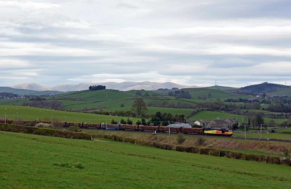 60095. 6J37. Milnthorpe, Mon 3 April 2017 - 1611.  Colas Rail's 1159 Carlisle yard - Chirk logs, not running via the just reopened Settle line.