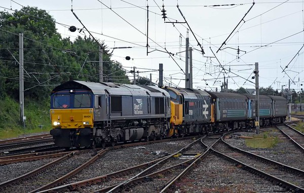 66424 & 37424 Avro Vulcan XH558 (dead), 5C48, Carnforth, Sat 15 July 2017 - 2003.  The demic ecs sets off for Kingmoor.  37424 had failed at Roose on Northern's 2C48 1156 Carlisle - Lancaster.  The coaches were 6122, 5971, 6064 & DBSO 9709.  37424 / 9707 had failed at Maryport on the 12th, again causing significant disruption; then the problem was reportedly with the DBSO.