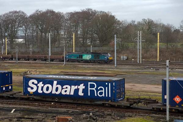 68003 Astute, 6K05, Carlisle yard, Tues 24 January 2017 - 1052.  DRS's 1102 departmental passes the 4S43 Tesco Express as it sets off for Basford Hall via Shap.