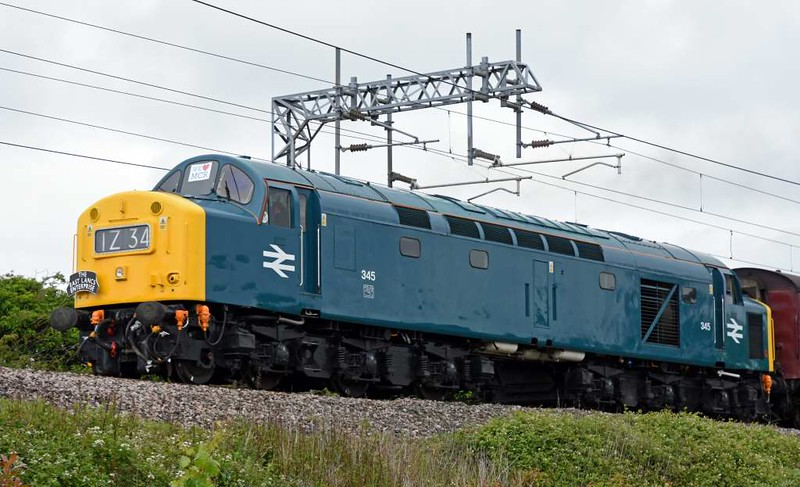 345 (40145). 1Z34, Carnforth, Fri 9 June 2017 - 1240.  The 40 - with a We love MCR sticker in the middle window - sets off for the East Lancashire Railway with the Class 40 Preservation Society's passenger-carrying stock move via Chester, Shrewsbury and Stafford.  The stock was being moved for the following day's CFPS tour to Blaenau Ffestiniog.  The 10 coaches were 4905, 99722, 5035, 4994, 99318, 99304, 99122, 99127, 4984 & 4854, and 37516 was on the rear.  The 40 had run light from the ELR to Carnforth earlier.