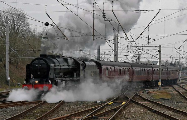 46115 Scots Guardsman, 1Z32, Carnforth, Sat 11 March 2017 - 0923.  The Scot sets off with the Railway Touring Co's 0632 Manchester Victoria - Edinburgh Mid-Day Scot.  The 11 coaches were 80217, 99304, 4994, 4905, 99318, 99128, 99351 Sapphire, 99348 Topaz, 99712, 99350 Tanzanite & 3093 Florence.  Unfortunately 46115 ran low on coal which could not be brought forward in the tender while the loco was under the 25kV catenary.  47580 had to pilot the train from Abington loop to Edinburgh, reached 20 late.