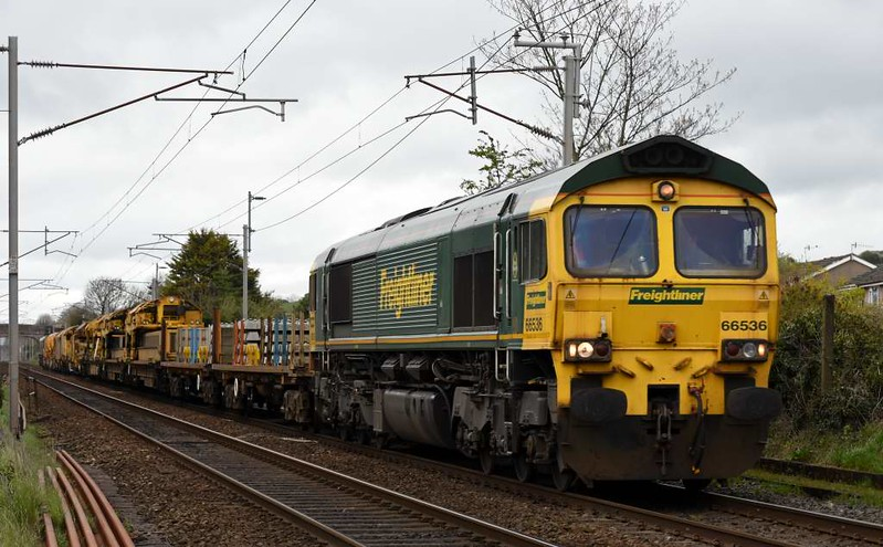 66536 & 66413, 6X04, Carnforth, Thurs 13 April 2017 - 1149.  Freightliner's Tyne yard - Cofton Junction (Longbridge) move with a Matisa P95 high output track renewal train. The consist was reported as 3170 4629 009-2, 3170 4629 018-3, DR78802, DR78812, DR78832, DR92465, DR92439 & 3170 9301 002-1.