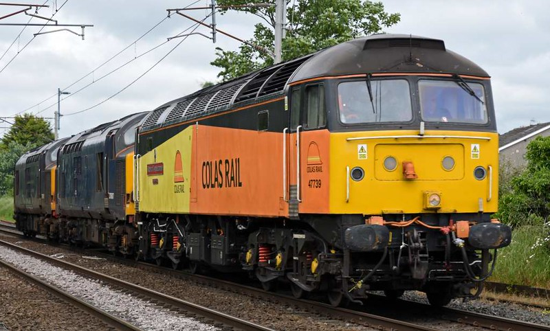 47739 Robin of Templecombe, 37607 & 37612, 0M56, Carnforth, Thurs 8 June 2017 - 1516 1.  Colas Rail's 1414 Carlisle - Barrow Hill move.  The former DRS 37s have been bought by Harry Needle and will go on hire to Colas after overhaul.  66433 had earlier brought them to Carlisle station from Longtown where they have been in store.