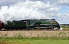 60009 Union of South Africa & 57315, 5M50, Capernwray, Wed 26 April 2017 - 1201 1.  The Streak sets off on a loaded test run round the Carnforth - Hellifield - Preston circuit.   The load was support coach 35486, 1860, 99327, 99328, 4905, 99304 and the 57.  60009 had arrived at Steamtown earlier that morning from the East Lancashire Railway where it has been under repair by Ian Riley.  It ran to York on the 28th with 47746 to haul the annual Great Britain land cruise but, as the steam leaking from the cylinder shows, it was not completely fit and did not take part.
