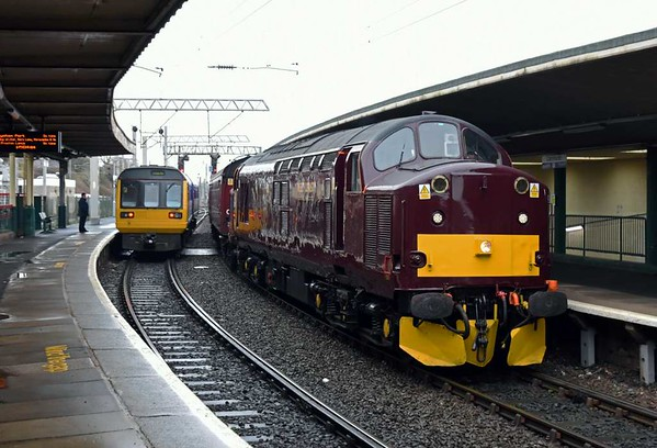 142017 (2H84) & 37706 (5Z41), Carnforth, Fri 17 March 2017 - 1207.   Northern's 1017 Leeds - Heysham waits for the road as WCRC's 0945 Steamtown - York sets off with the ECS for the following day's Whitby Flyer railtour.  It comprised 99304, 4994, 4905, 99318, 99351 Sapphire, 99348 Topaz, 99712, 99350 Tanzanite & 3093 Florence.  The stock was the same as for 46115's Midday Scot on the 11th except that 99128 had been removed.